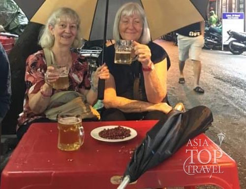 Sunita and Susan enjoy Hanoi Beer Hoi on a Hanoi street food tour